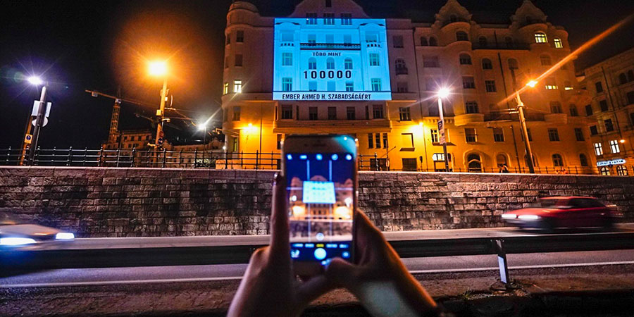 An image is projected on a building in Hungary