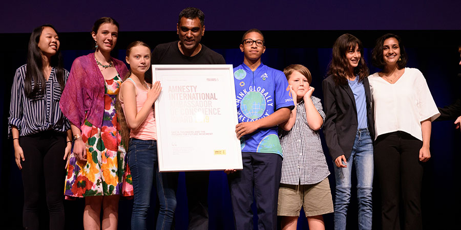 Greta Thuberg and Fridays for Future activists accept their Ambassador of Conscience Award.